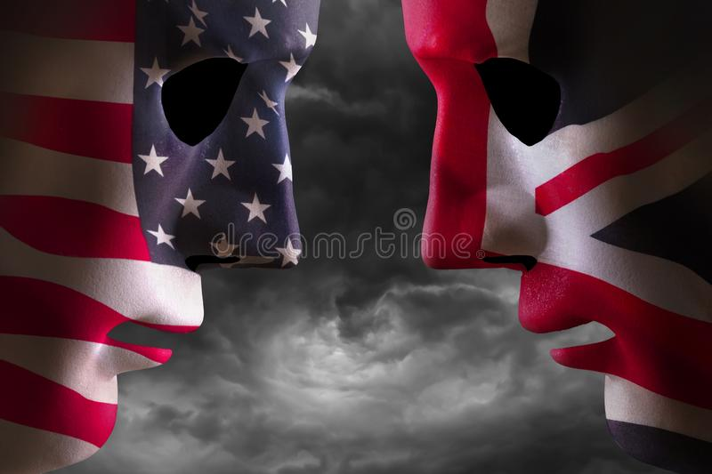 Head to head USA and UK flag faces. Head to head USA and UK faces with flag textures over the faces. Stormy clouds background royalty free stock photos