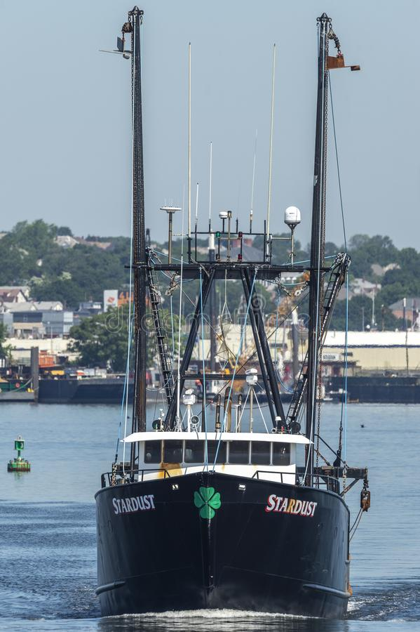 Head-on view of commercial fishing boat Stardust leaving New Bedford. New Bedford, Massachusetts, USA - June 28, 2019: Commercial fishing vessel Stardust going royalty free stock photo