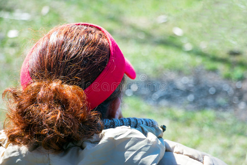 Head woman. Rear view. The woman has red hair stock photography