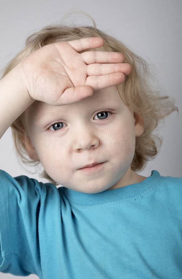 A young boy with arm extended arm pointing his finger