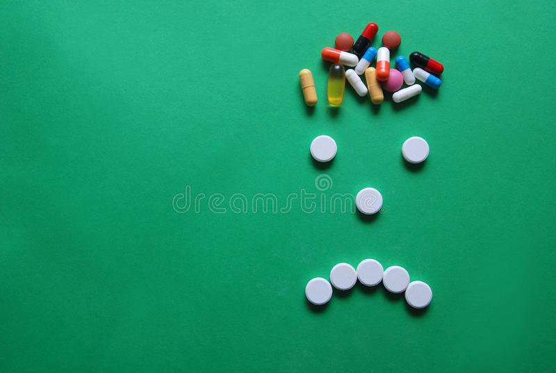 Headache caricature with pills stock image