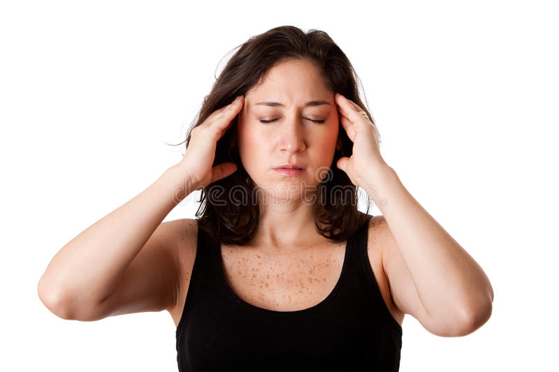 Headache migraine. Face of beautiful young attractive woman with headache migraine unwell expression feeling sick, holding her head, isolated stock photo