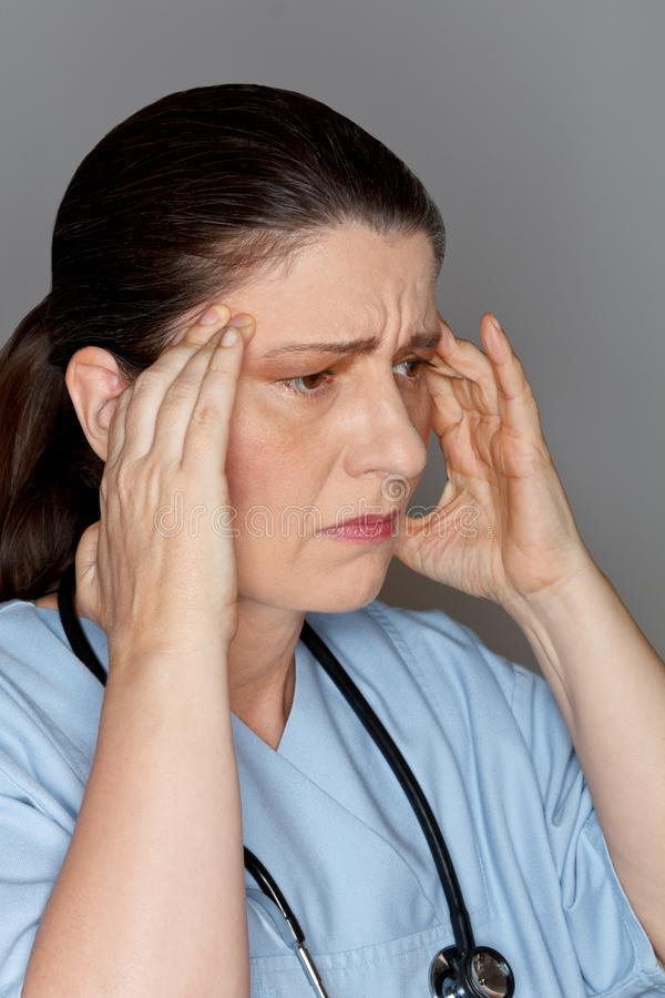 Headache migraine pain female nurse doctor royalty free stock images