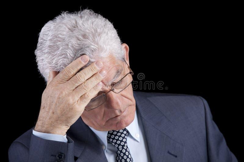 Headache on a senior businessman royalty free stock photo