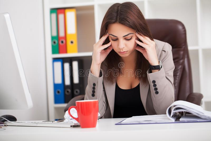 Headache and Stress at Work. Portrait of Young Business Woman at. Her office stock photos