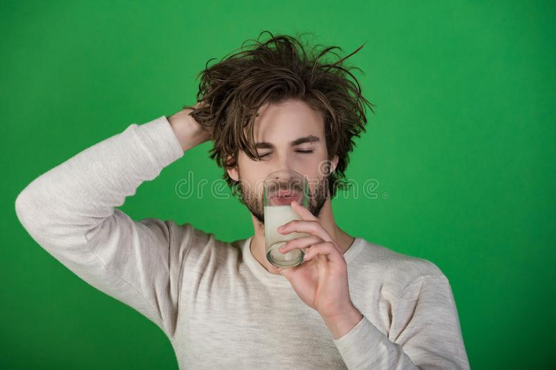 Headache treatment, hypnotic tablet. Health and medicine, flu and cold. Man with water glass, hangover. Man drink pill with water, illness, insomnia stock photos