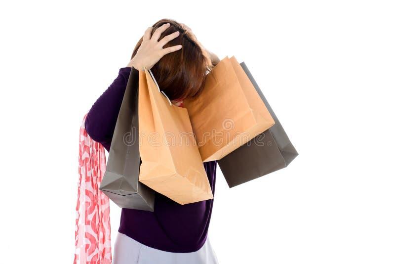 Headache Woman holding few shopping bags stock photo