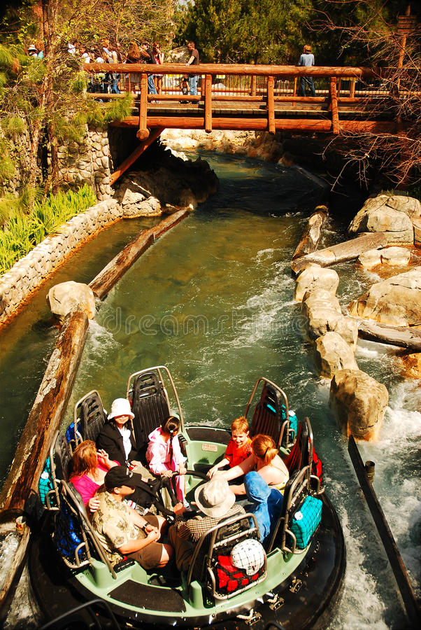 Headed to the Rapids. A group of Theme Park riders head to a rapid ride stock image