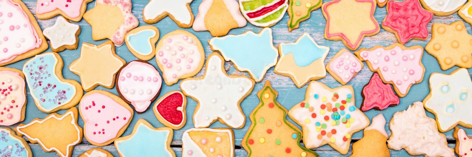 Header, colorful christmas cookies with royal icing and sugar pearls. Header, colorful christmas cookies with royal icing, frosting and sugar pearls royalty free stock photo
