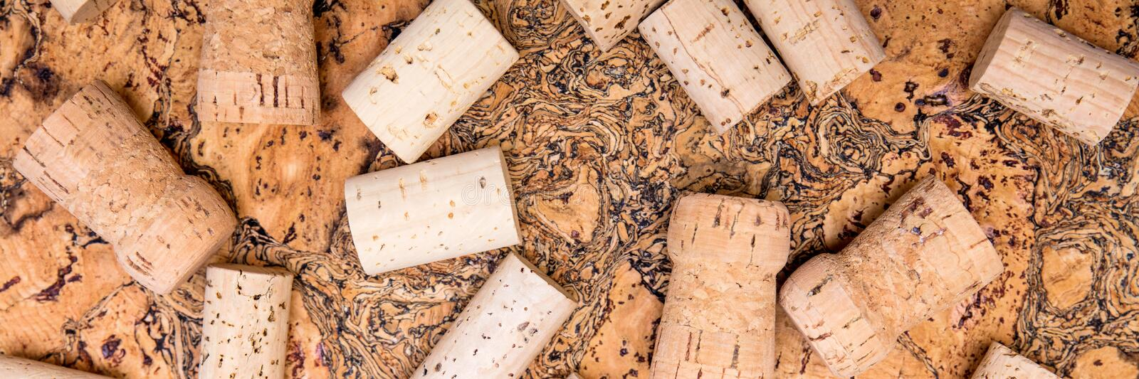 Header, wine and champagne cork spreading on untreated cork. Naturally product royalty free stock photo