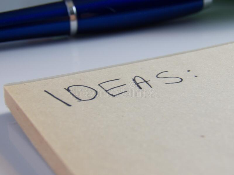 Heading Ideas on white paper royalty free stock photography