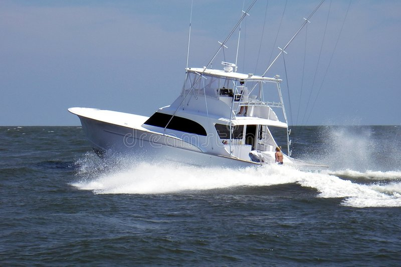 Heading Offshore. Photo of million dollar high speed sportfishing boat heading offshore of Ocean City Maryland. The captain may be running offshore to see how