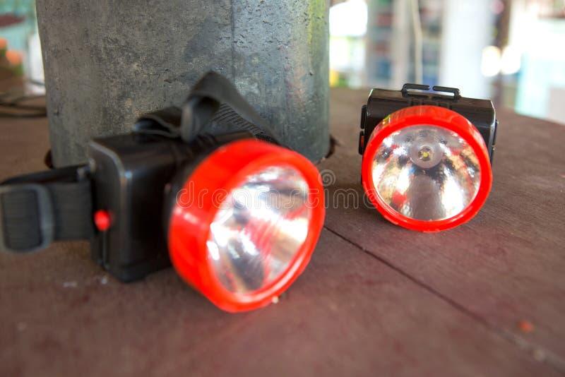 headlamp prowadzący Mała latarka z patkami dla głowy fotografia stock