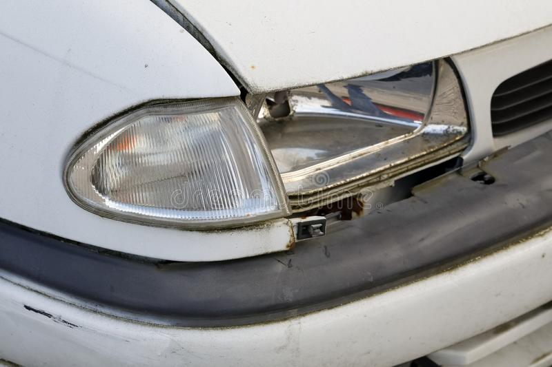 The car is broken and the headlamp is damaged. The headlamp was broken down as a result of a small road collision royalty free stock photography