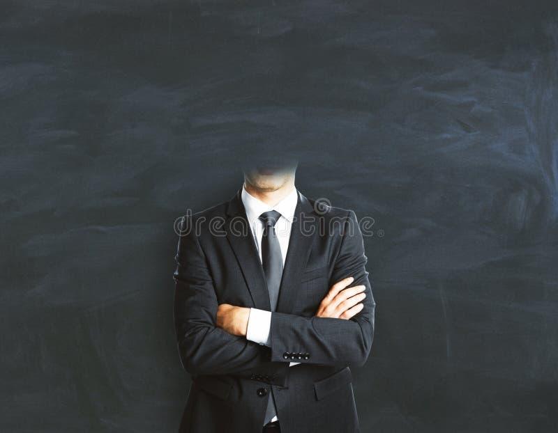 Headless businessman on chalkboard background royalty free stock photo