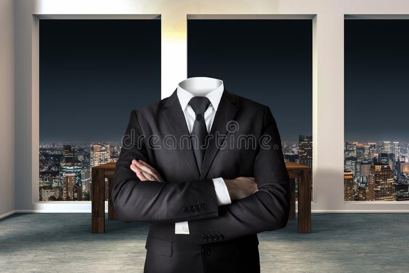 Headless businessman with crossed arms in modern urban office stock photography