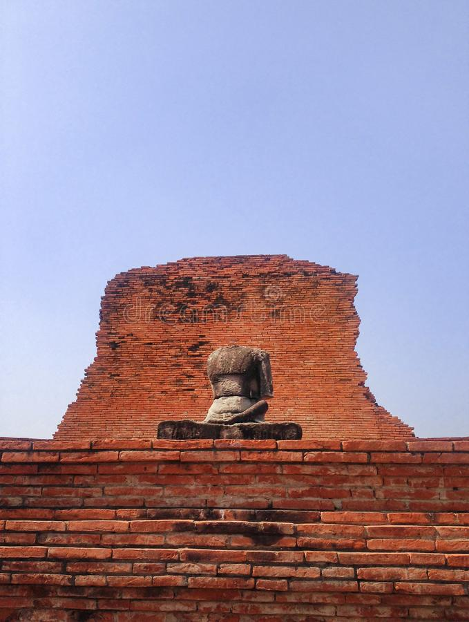 Headless, one handless of old laterite buddha statue royalty free stock photography