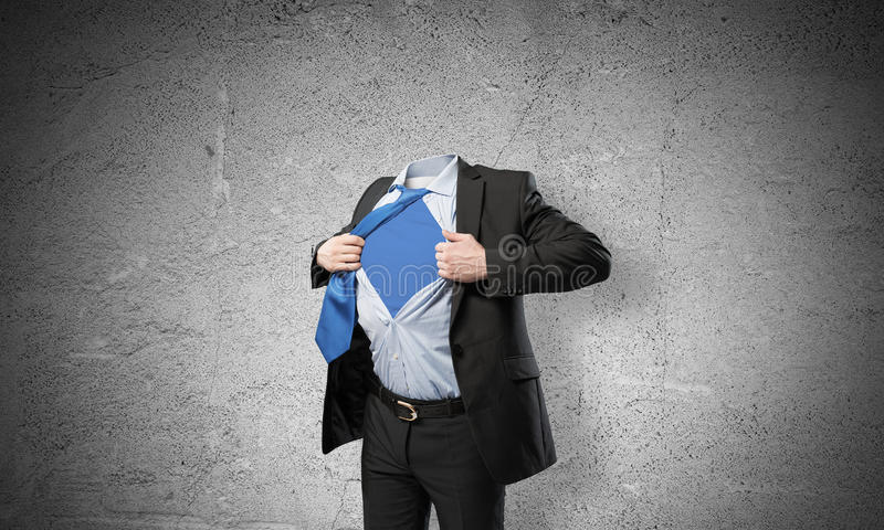 Headless super businessman. Headless businessman in black suit acting like super hero stock photography