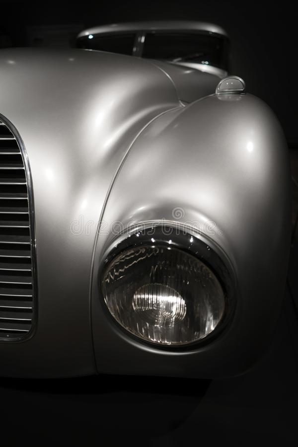 Free Headlight And Grille Elegant Silver Retro Car On Dark Background Royalty Free Stock Image - 139804396