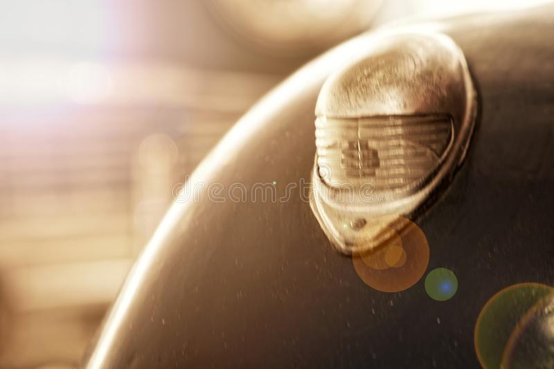 Headlight of antique old car, detail on the headlight of a vintage car. Selective focus royalty free stock images