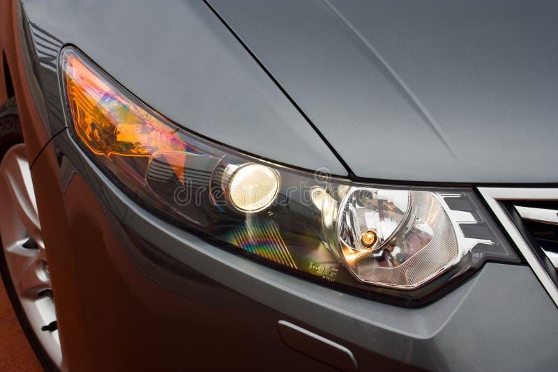 Headlight of a car stock photography