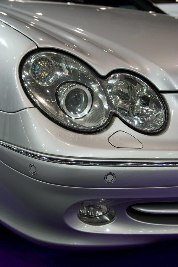 Headlight of car. Headlights of German, grey metallic, luxury passenger car royalty free stock photos