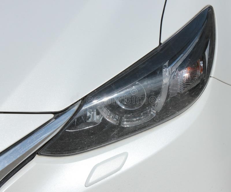 Headlight of the car. Headlamp with clear glass, white passenger car stock image