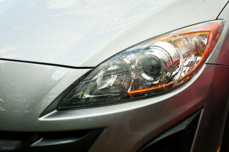 Headlight of grey car