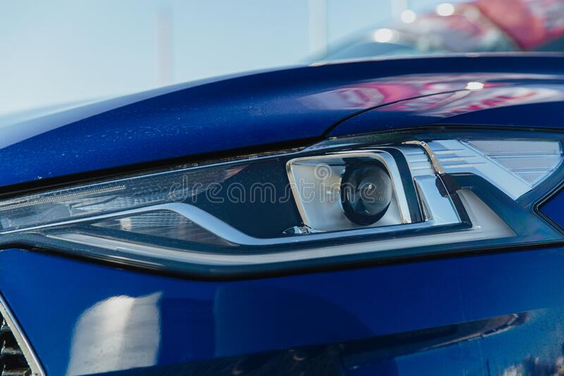 Headlight Of Modern Car. Headlight Of A Modern Car. The car is blue stock images
