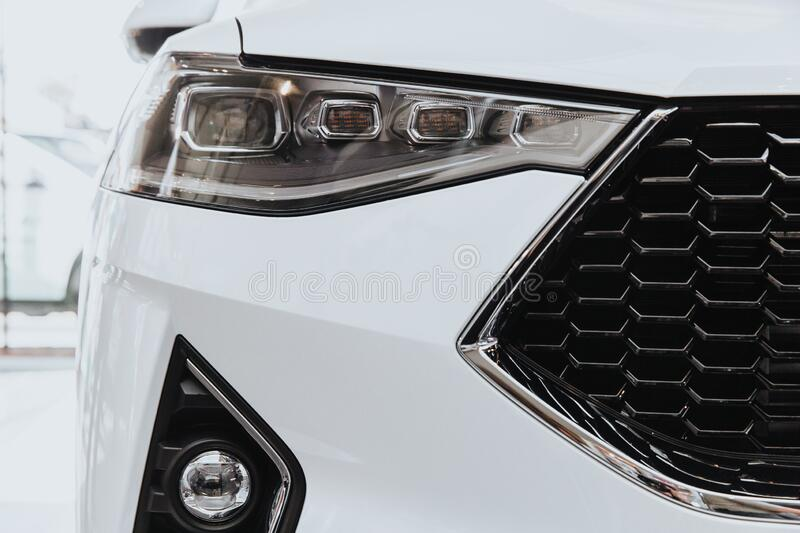 Headlight Of Modern Car. Headlight Of A Modern Car. The car is white royalty free stock photo