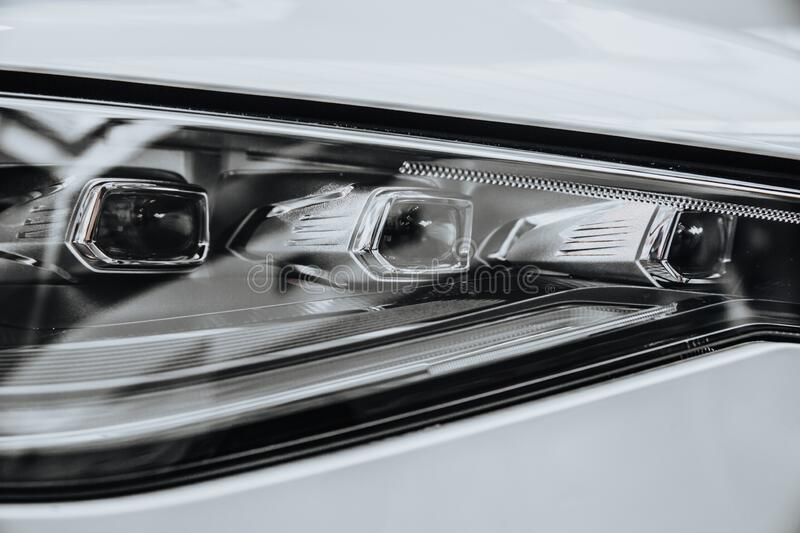 Headlight Of Modern Car. Headlight Of A Modern Car. The car is white royalty free stock photography