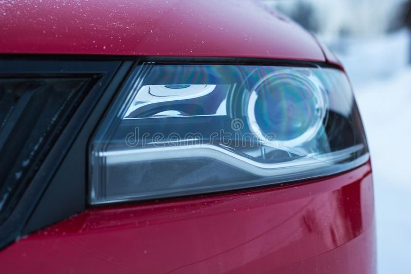 Headlight of modern prestigious car close up royalty free stock image