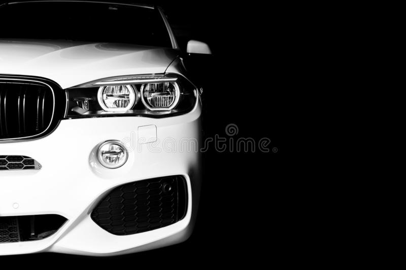 Headlight of a modern white sport car. The front lights of the car. Modern Car exterior details. Car detailing. Isolated on black. Background. Car detailing royalty free stock photos