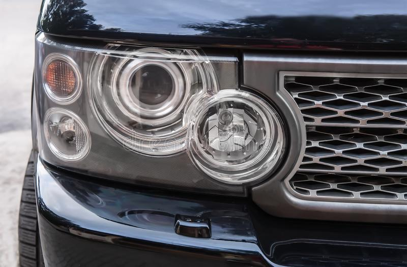 headlight of prestigious car close up stock image