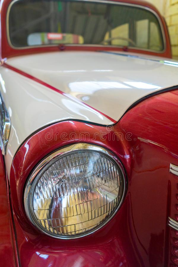 Red antique car. The product of the automotive industry. stock photos
