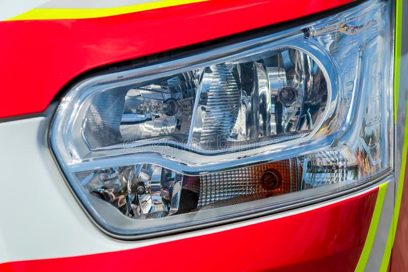 Headlight of red car with white stripes. royalty free stock images