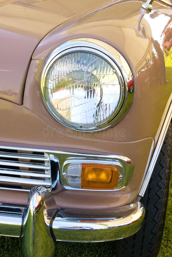Headlight in red england mini vintage car royalty free stock images