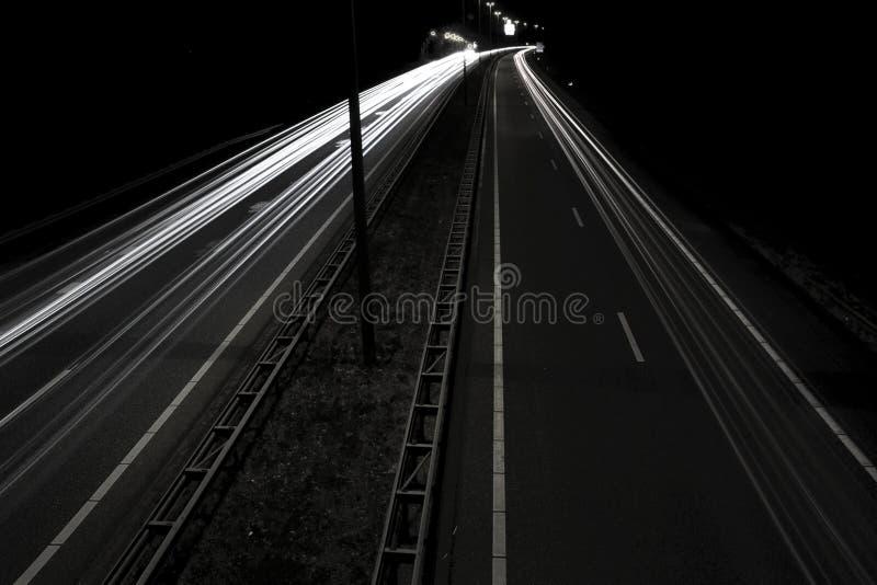 Headlight streaks on dark road