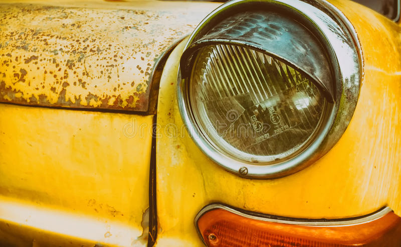 Headlight yellow vintage car. royalty free stock photography