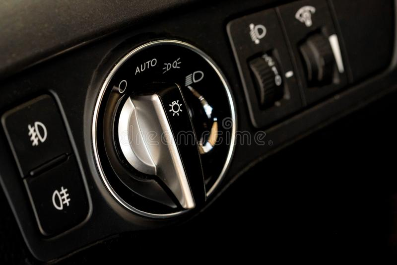 Headlights control unit in the new car close stock photo