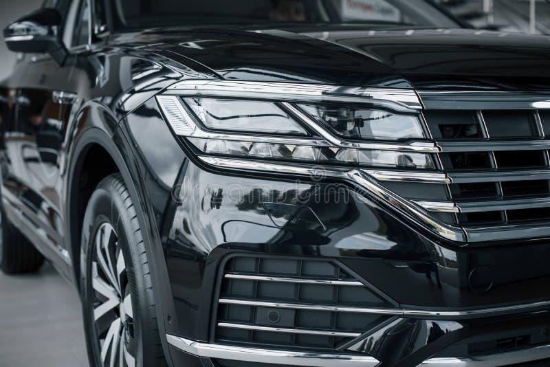 The headlights of a new modern prestigious black car. royalty free stock image
