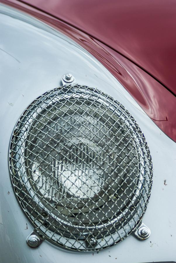 Headlights with protective grille an oldtimer Porsche 356 Carrera Speedster GT during a rally stock photo