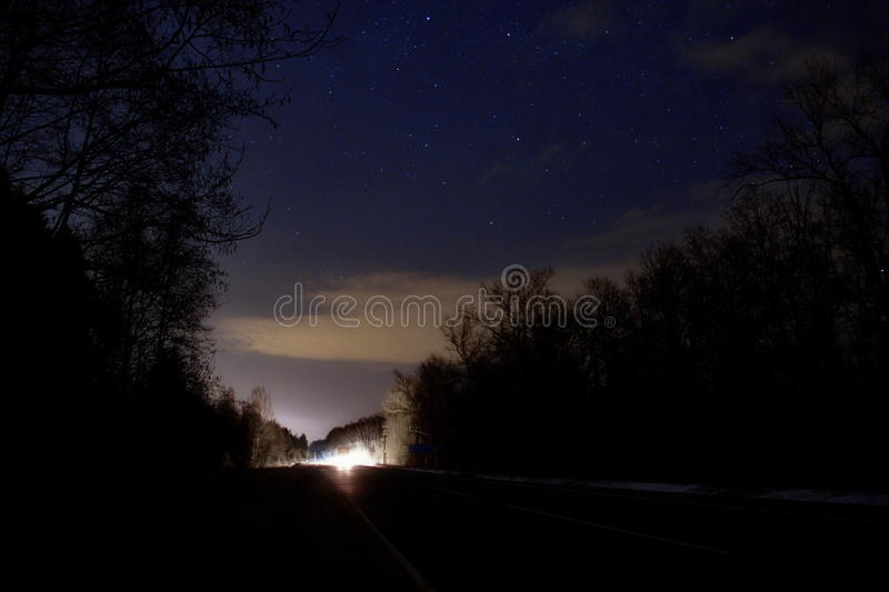 Headlights on the road to the stars royalty free stock photography