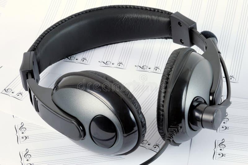 Headphone. A headphone on blank staffs stock photo