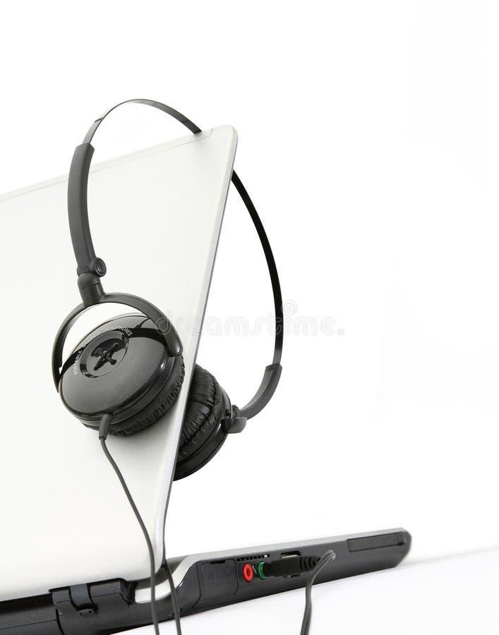 Headphone. A headphone on a notbook PC stock image