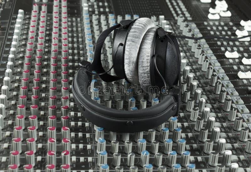 Headphone on a studio mixer stock photography