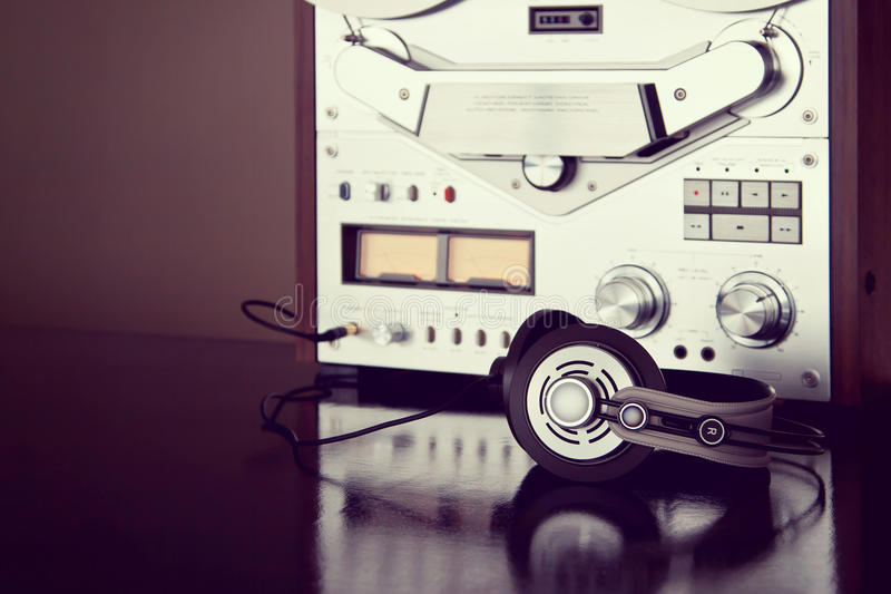 Headphones with Analog Stereo Open Reel Tape Deck Recorder Vintage. Detailed Closeup royalty free stock photography