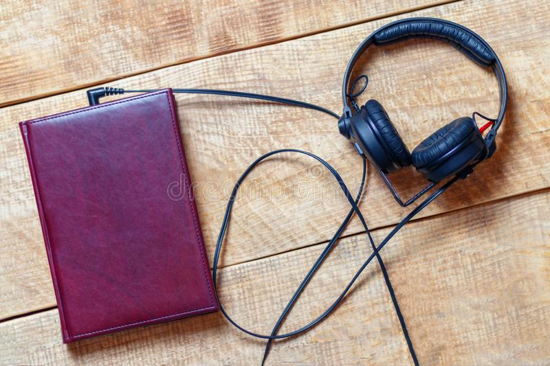 Headphones with a book, concept the audiobook royalty free stock images