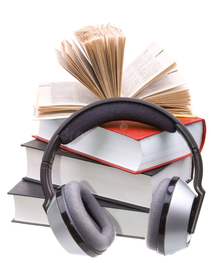 Headphones and books royalty free stock photo