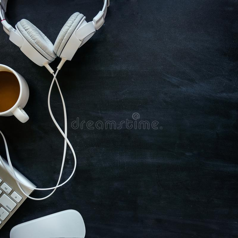 Headphones with cable on a black table stock photo